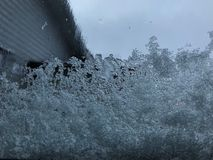 White snow flake cover on the windshield of the car in winter stock photography