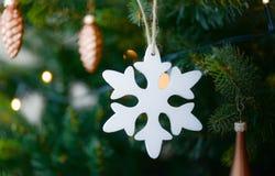White Snow Flake Hanging on Christmas Tree stock photos