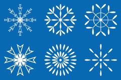 White snow flakes set. Sign isolated on blue background Royalty Free Stock Photo