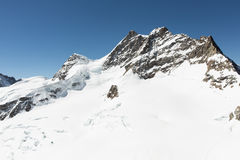 White snow mountain. At Jungfrau stock image