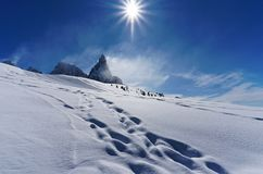 White snow mountain panorama sunny day. White snow mountain panorama in a sunny day stock image