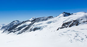 White snow mountain. View from jungfraujoch stock photography