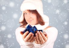 White snow queen giving a present Stock Image