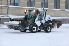 White Snow Removal Tractor in City royalty free stock photo