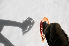 White snow and a snowshoe with shadow. In mountain Royalty Free Stock Images