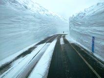 White Snow Wall. Road to White Snow Alpine Wall Royalty Free Stock Photo