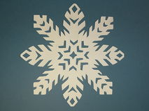 White snowflake. On the blue background, isolated, trimming Royalty Free Stock Images