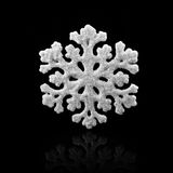 White Snowflake on black background. Winter symbol.  royalty free stock photography