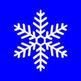 White snowflake on a blue background Stock Images