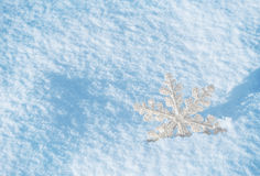 White snowflake on a blue snow Stock Photo