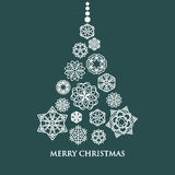 White snowflake Christmas tree on green background Royalty Free Stock Photos