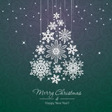 White snowflake Christmas tree on green background Royalty Free Stock Photo