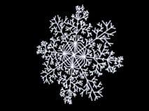 White snowflake close up. Close up of white snowflake on black background Stock Illustration