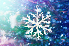 White snowflake. Decorates the fir tree on Christmas holidays royalty free stock photos