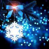 White snowflake on a glitter blue background. Royalty Free Stock Photography