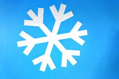 White snowflake on light blue background Royalty Free Stock Photography
