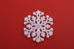 White Snowflake on Red Stock Images