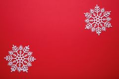 White snowflake on a red background. Christmas concept. royalty free stock photo