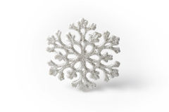 White Snowflake on a white background. Winter Stock Image
