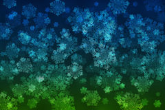 White snowflakes on an abstract blue and green background. Illustration Royalty Free Stock Image