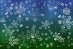 White snowflakes on an abstract blue and green background. Illustration Royalty Free Stock Images