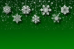 White snowflakes on an abstract green background. Illustration Stock Images