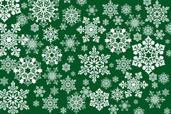 White snowflakes on an abstract green background. Illustration Stock Image