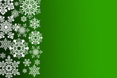 White snowflakes on an abstract green background. Illustration Royalty Free Stock Photography