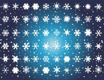 White snowflakes on blue background Stock Image