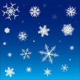 White snowflakes on a blue background Royalty Free Stock Images
