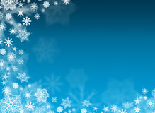White snowflakes on a blue background. Christmas background is. White snowflakes on a blue background Royalty Free Stock Photography