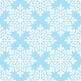 White snowflakes on blue background seamless pattern Stock Photography