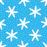 White snowflakes on blue background. Seamless pattern. Drawn by hand. stock illustration