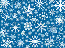 White snowflakes on blue background. White snowflakes, in varying shapes and sizes, on a blue background vector illustration