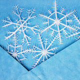 White snowflakes in the blue envelope Stock Photo