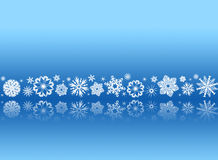 White snowflakes on blue with reflections Royalty Free Stock Image