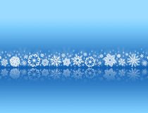 White snowflakes on blue with reflections Royalty Free Stock Photo