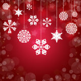 White snowflakes. Christmas background. White snowflakes on a red background Royalty Free Stock Images