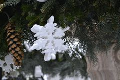 White snowflakes and Christmas-tree balls, and cones stock photo