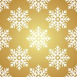 White snowflakes on Golden background seamless pattern royalty free stock photo