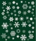 White snowflakes on green background Royalty Free Stock Image