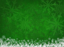 White snowflakes on green christmas background.  Stock Photo