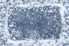 White snowflakes on ice Royalty Free Stock Photography