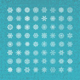White snowflakes icon on blue background. Stock Photos