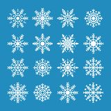 White snowflakes isolated on blue background. Snowflake symbol of Christmas and New Year. Abstract snowflake pattern. Holiday ornament element. Vector royalty free illustration