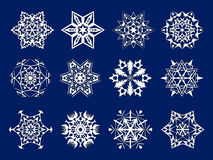 White snowflakes kirigami. A set of 12 white snowflakes kirigami on a dark background Royalty Free Stock Photography