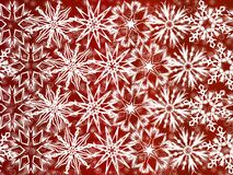 White snowflakes on red background Stock Photos