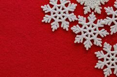 White snowflakes on red background new year Christmas holiday royalty free stock photos
