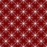 White snowflakes on red background seamless pattern Stock Image