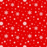 White snowflakes on a red background, seamless pattern. Vector. Snowflake seamless pattern. White snowflakes on a red background. Vector. Symbol of winter Royalty Free Stock Photo